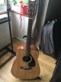Yamaha F310 Accoustic Guitar, stand, bag and electric tuner