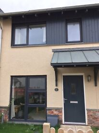 Unfurnished 2 bed new build house for rent Dartington near Totnes, parking, solar hot water, garden