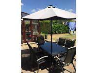 Patio table, chairs and parasol