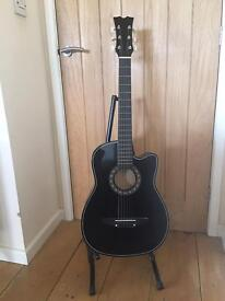 3/4 size acoustic guitar, bag, stand and digital tuner.