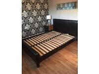 Brown faux leather kingsize bed