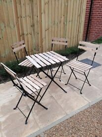 Wooden garden patio table and chairs
