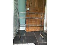 Chrome/silver towel rail and toilet roll holder