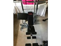 York Weights Bench plus weights, bar and dumbbell bars.