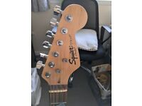 Squire Fender Strat guitar with Amp. Strap, Bag & Stand included.