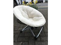Foldable sheepskin style chair for young child.