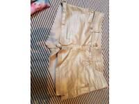 Gold glittery shorts. S8