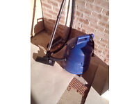 blue cyilinder hoover made by hoover with hoover bags