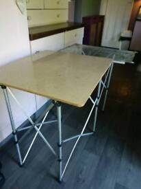 Twin table portable in carry bag. One side grill, one side wipable table