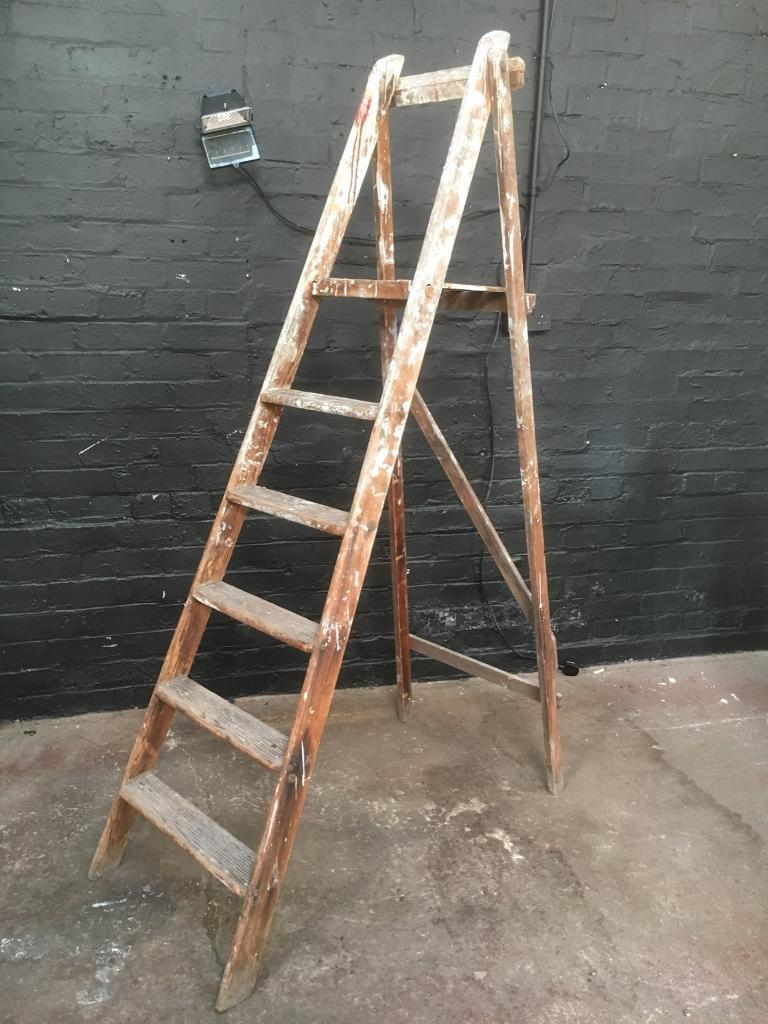 Tall vintage wooden ladders in nice strong condition