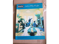 Oasis music song book - Definitely maybe.