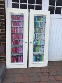 Pair of cupboard doors- look like bookshelves. Cool stylish decorative and practical