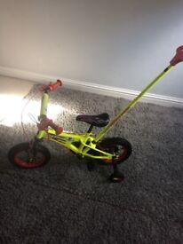 Child's bike with detachable handle