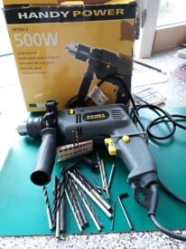 Hammer drill with reverse and drill bits and chuck buyer collects