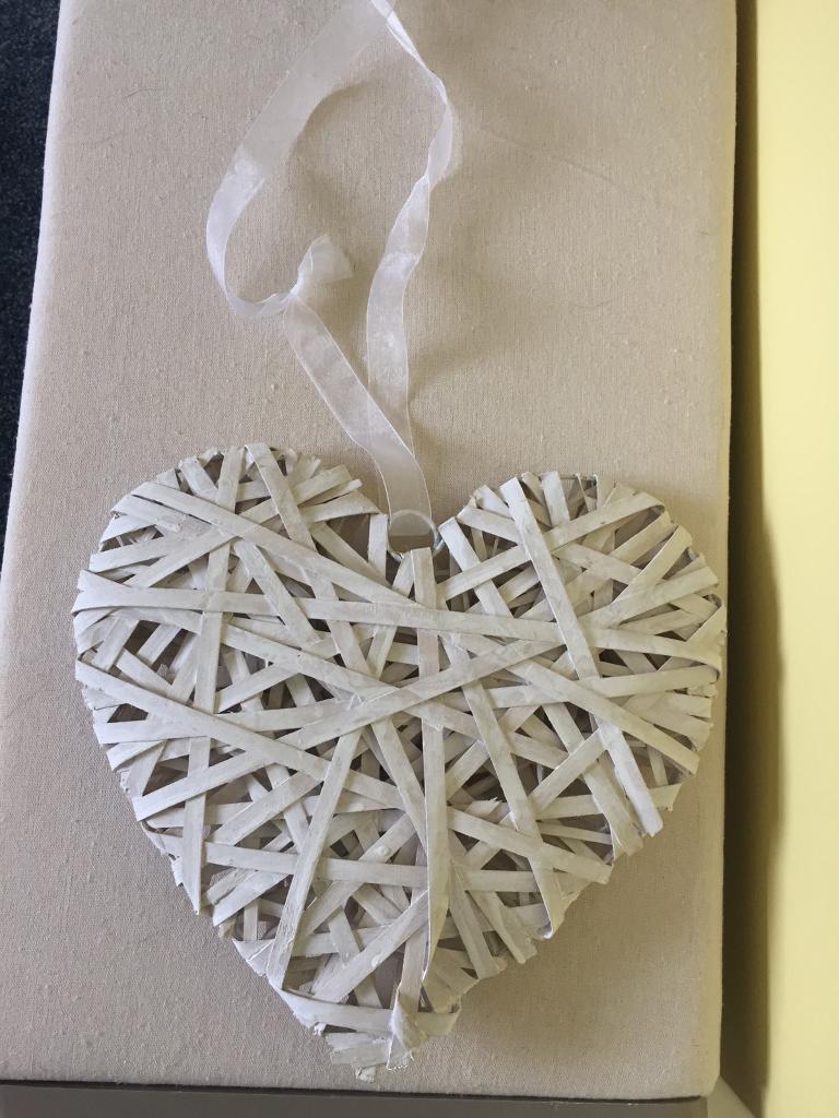 White wicker hearts wedding decoration