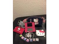 Pink ds with games and hello kitty accessories