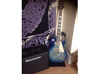 Blue Sunburst Epiphone Les Paul in mint condition for sale with amp, cable and guitar case