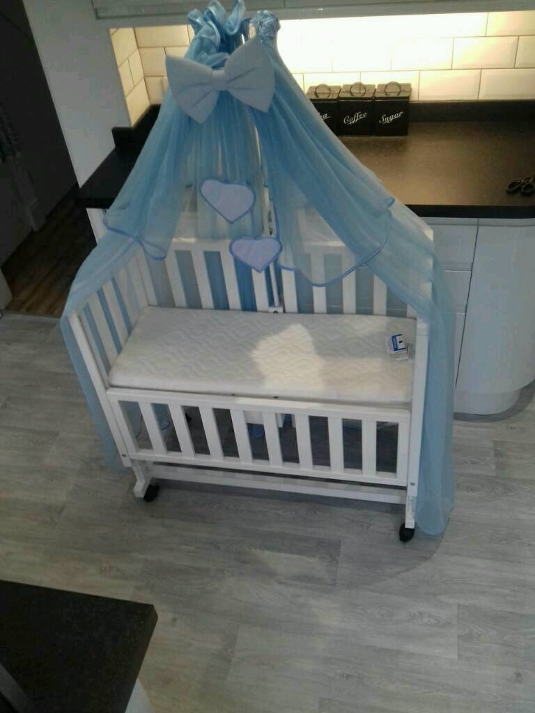 Bedside crib and Mattress with blue voille canopy