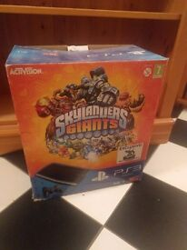 PlayStation 3 console with Skylanders Giants and 2 more games