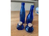 Ornamental blue glass bottles