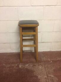 Vintage wooden stool with leather top