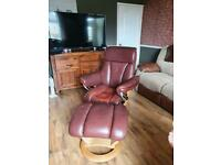 Reclining leather chair with matching stool
