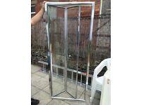 Glass folding shower doors