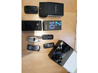 Selection of mobile phones and chargers
