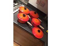 Set of Le Creuset pans (orange)