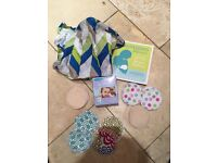 Various Breast Feeding Items (storage bags, cover, book)
