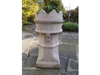 Garden planter, shaped as a chess piece, concrete formed, very sturdy.