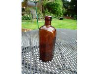 Old octagonal brown glass MIlton bottle