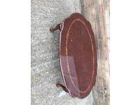 Coffee table- dark mahogney wood. Shiny finish. Good condition.