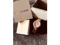 Petite rose gold Michael Kors stamped warranty booklet included