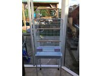 Medium bird cage with opening top and toys included, very good condition.