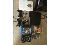 PS3 + 16 games + 15 blue-Ray films