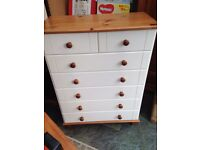White chest of drawers. with pine top .