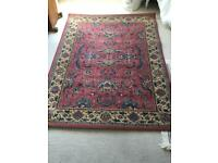Woven floral patterned rug