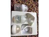 Breast pump and baby bottles x2