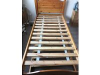 Single bed with guest bed under