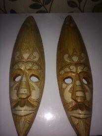 2 wooden masks