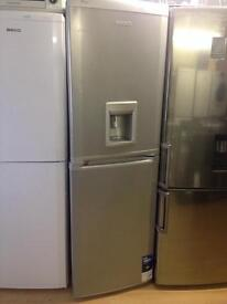 Silver fridge freezer with waterdispenser