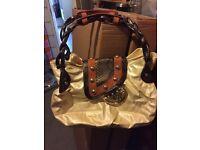 Paris Hilton cream large handbag
