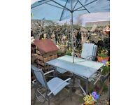Rectangular garden table and 6 chairs with brolly and stand