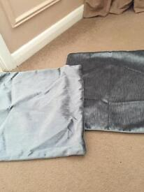 Two silver grey cushion covers