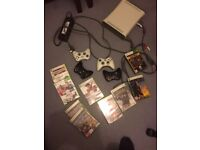XBox360, power pack and av leads, four wireless controllers and ten games