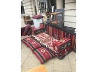 Asian bed / Sofa multi coloured quality cushions etc. For sale at a bargain price of £100.