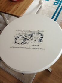 lovely cream round table with french decal