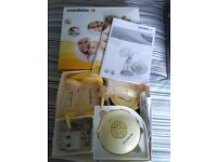 Medela Swing Electric Breast Pump with Calma and accessories