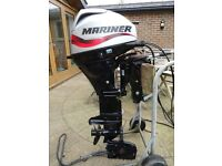 Outboard Engine . Mariner 20hp Four Stroke. Remote Control. Long Shaft. Power trim. Mint condition.